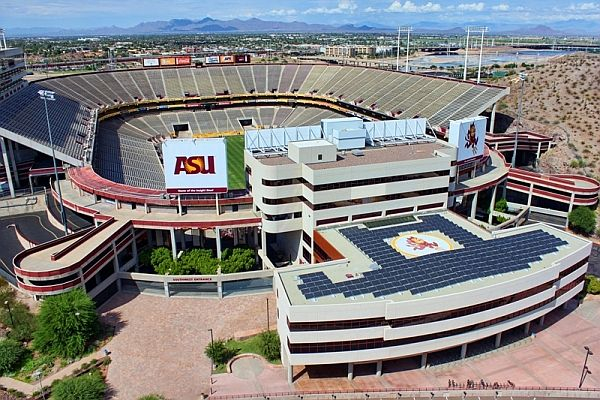 A solar powered parking deck overlooks the ASU stadium. Many sports venues are adding solar panels for power generation and financial savings.
